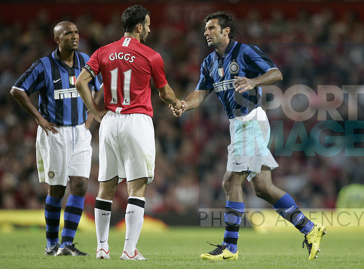 timeless design da91a 0d413 Manchester United's Ryan Giggs shakes hands with Luis Figo ...