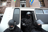 "Special police forces ""Berkut"" during the failed assault on town hall. Kiev Ukraine.<br /> <br /> Protesters did not give up after the faint  attempt of evacuation performed by the police of the night before. Despite the adverse weather conditions,  they restored and rebuilt the complex structures of the  barricades under the snow in Maidan square. Kiev,  Ukraine."