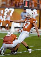 30 September 2006: Texas kicker Greg Johnson (#97) kicks an extra point held by Jordan Shipley (#8) during the Longhorns 56-3 victory over the Sam Houston State Bearkats at Darrell K Royal Memorial Stadium in Austin, TX.