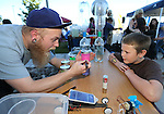 Jordan Dargert, with the Western Nevada College physics department, performs Fun with Science demonstrations for Zach Kitht, 10, during the Journey of Hope event in Carson City, Nev., on Friday, June 12, 2015. Nearly 30 cyclist rode into town Friday as part of the Pi Kappa Phi fraternity&rsquo;s cross-country ride to bring awareness and support to people with disabilities.<br /> Photo by Cathleen Allison/Nevada Photo Source