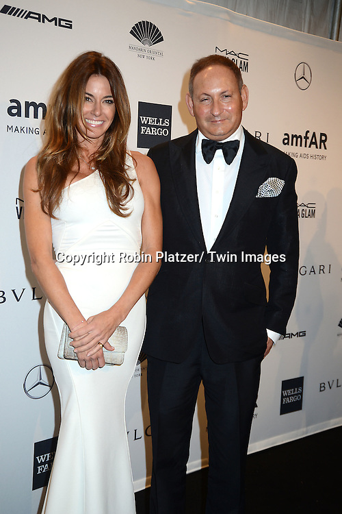 Kelly Bensimon and John Demsey attends the amfAR New York Gala on February 5, 2014 at Cipriani Wall Street in New York City.