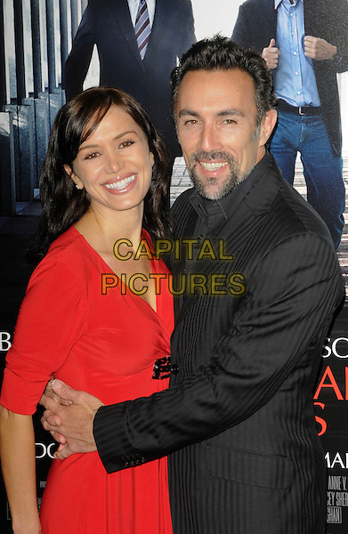 "JULIE McCANN & FRANCESCO QUINN .arriving at the premiere of ""Extraordinary Measures"" at Grauman's Chinese Theatre in Hollywood, California, USA,   January 19th, 2010..arrivals half length married couple husband wife red dress black suit grey gray pinstripe arm around beard facial hair goatee .CAP/ROT.©Lee Roth/Capital Pictures"