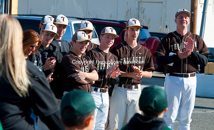 THOMASTON,  CT--- -041616JS07--Members of the Thomaston High School baseball team cheer on little league players during the Thomaston Little League opening day parade to Reeves Field in Thomaston on Saturday. <br /> Jim Shannon Republican-American