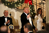 United States President Donald J. Trump with First Lady Melania Trump and US Vice President Mike Pence (L) greet guests at the Congressional Ball at White House in Washington on December 15, 2018. <br /> Credit: Yuri Gripas / Pool via CNP