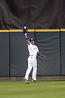 Round Rock Express outfielder Endy Chavez makes a catch against the Omaha Storm Chasers in Pacific Coast League baseball on Monday April 11th, 2011 at Dell Diamond in Round Rock Texas.  (Photo by Andrew Woolley / Four Seam Images)