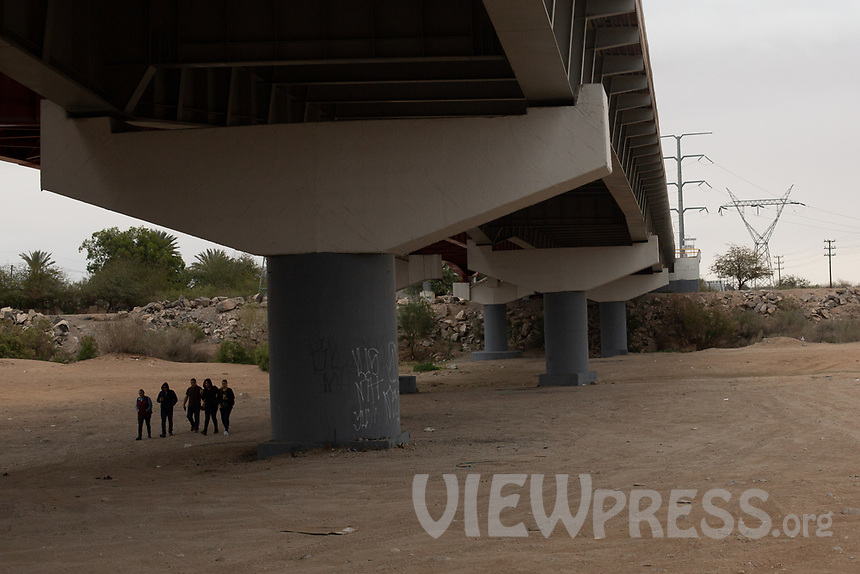 MEXICALI, MEXICO - March 11 . People walk under the bridge on the Dry river bank of the Colorado River on March 11, 2019 in Mexicali, Mexico.<br /> The rivers usually end in the sea, the Colorado dies in a border. Its the only case like this in the world. There is less water in the Colorado River, hence less water in crops and areas of northern Mexico.  <br /> (Photo by Luis Boza/VIEWpress)