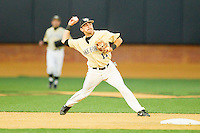 Pat Blair (11) of the Wake Forest Demon Deacons makes a throw to first base against the North Carolina State Wolfpack at Wake Forest Baseball Park on March 15, 2013 in Winston-Salem, North Carolina.  The Wolfpack defeated the Demon Deacons 12-6.  (Brian Westerholt/Four Seam Images)