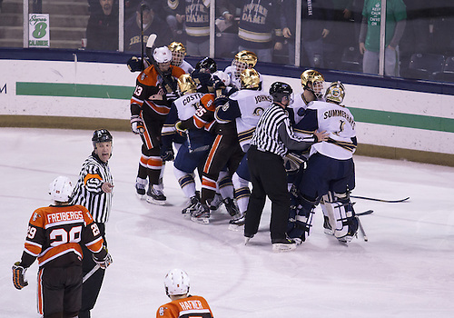 March 15, 2013:  Players scrap after the whistle during NCAA Hockey game action between the Notre Dame Fighting Irish and the Bowling Green Falcons at Compton Family Ice Arena in South Bend, Indiana.  Notre Dame defeated Bowling Green 1-0 in overtime.