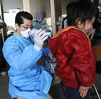 People are teste for radiation at the Azuma Sports Park outside that has been designated a shelter at Fukushima City, and area, 60 km from the from the Fukushima Daiichi Nuclear Power Plant. Plant was damaged dring the  Earhquake and following Tsunami that struck Japan 11th March 2011.<br />