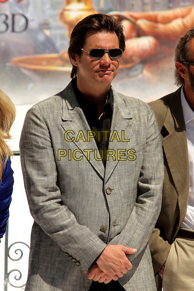 JIM CARREY.'A Christmas Carol' photocall 62nd International Cannes Film Festival Cannes, France..May 18th, 2009 .half length black grey gray jacket sunglasses shades .CAP/CAS.©Bob Cass/Capital Pictures.
