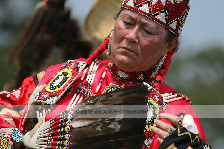 A Native American woman dances in full traditional regalia at the 8th Annual Red Wing Native American PowWow in Virginia Beach, Virginia.