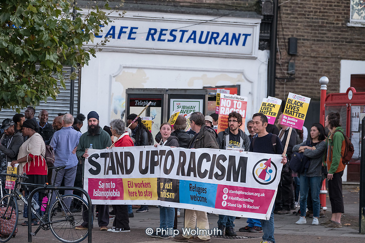 Black Lives Matter, Stand Up To Racism protest in Harlesden, London, outside a cafe where a young black man was assaulted by police.