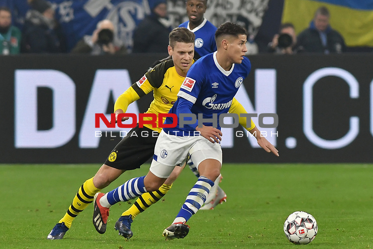 08.12.2018, Veltins-Arena, Gelsenkirchen, GER, 1. FBL, FC Schalke 04 vs. Borussia Dortmund, DFL regulations prohibit any use of photographs as image sequences and/or quasi-video<br /> <br /> im Bild v. li. im Zweikampf Lukasz Piszczek (#26, Borussia Dortmund) Amine Harit (#25, FC Schalke 04) <br /> <br /> Foto &copy; nordphoto/Mauelshagen