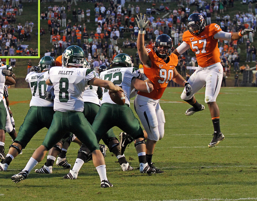 Oct 23, 2010; Charlottesville, VA, USA;  Virginia Cavaliers defensive end Jake Snyder (90) and Virginia Cavaliers linebacker Darnell Carter (57) defend against Eastern Michigan Eagles quarterback Alex Gillett (8) during the game at Scott Stadium.  Virginia won 48-21. Mandatory Credit: Andrew Shurtleff
