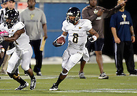 Florida International University quarterback Loranzo Hammonds Jr. (8) plays in the Spring Game on March 30, 2012 at Miami, Florida. .