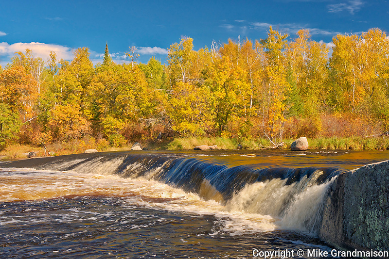 Whiteshell River flows into White Lake at Rainbow Falls in autumn<br />