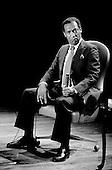 Denver Colorado<br /> USA<br /> June 10, 1983<br /> <br /> Comedian Bill Cosby performs at McNichols Sports Arena. <br /> <br /> William Henry &quot;Bill&quot; Cosby, Jr. (born July 12, 1937) is an American comedian, actor, author, television producer, educator, musician and activist. A veteran stand-up performer, he got his start at various clubs, then landed a starring role in the 1960s action show, I Spy. He later starred in his own series, the situation comedy The Bill Cosby Show, in 1969. He was one of the major characters on the children's television series The Electric Company for its first two seasons, and created the educational cartoon comedy series Fat Albert and the Cosby Kids, about a group of young friends growing up in the city. Cosby has also acted in a number of films.<br /> <br /> During the 1980s, Cosby produced and starred in what is considered to be one of the decade's defining sitcoms, The Cosby Show, which aired eight seasons from 1984 to 1992. The sitcom highlighted the experiences and growth of an upper-middle-class African-American family. He also produced the spin-off sitcom A Different World, which became second to The Cosby Show in ratings. He starred in the sitcom Cosby from 1996 to 2000 and hosted Kids Say the Darndest Things for two seasons.<br /> <br /> He has been a sought-after spokesman, and has endorsed a number of products, including Jell-O, Kodak film, Ford, Texas Instruments, and Coca-Cola, including New Coke. In 2002, scholar Molefi Kete Asante included him in his book, the 100 Greatest African Americans.