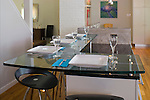 A glass countertop that serves as a breakfast/dining bar in a contemporary Richmond kitchen remodel.