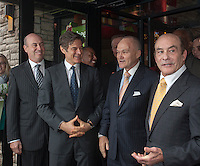 "(L-R) Apple-Metro Pres. Roy Raeburn, Dr. Mehmet Oz, NYPD Commissioner Ray Kelly and Apple-Metro CEO Zane Tankel at the grand opening of the new Applebee's casual dining restaurant in the East River Plaza shopping center in New York on Monday, December 10, 2012. The new restaurant, which is applying for LEED Gold certification, uses rainwater collected from the roof, waterless urinals and contains a ""Living Wall"" of plants to help purify the air among other eco-friendly features. (© Richard B. Levine)"