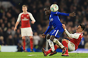 10th January 2018, Stamford Bridge, London, England; Carabao Cup football, semi final, 1st leg, Chelsea versus Arsenal; Alexis Sanchez of Arsenal tackles Ngolo Kante of Chelsea