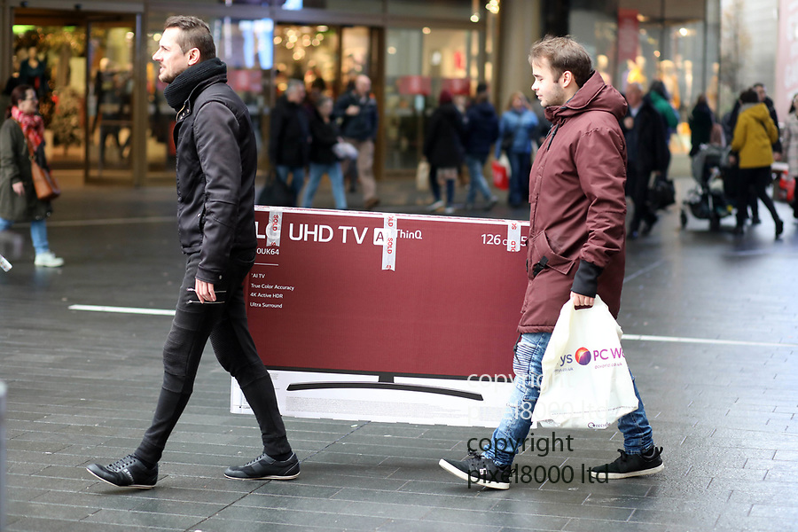 Pic shows: Black Friday sales<br /> <br /> Chaotic scenes at a packed Westfield in Stratford East London<br /> <br /> Happy with a new big TV<br /> <br /> <br /> <br /> <br /> <br /> pic by Gavin Rodgers/Pixel8000