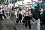 Crowd of passengers leaving their trains on the platform at Norwich railway station,<br /> Norfolk, England