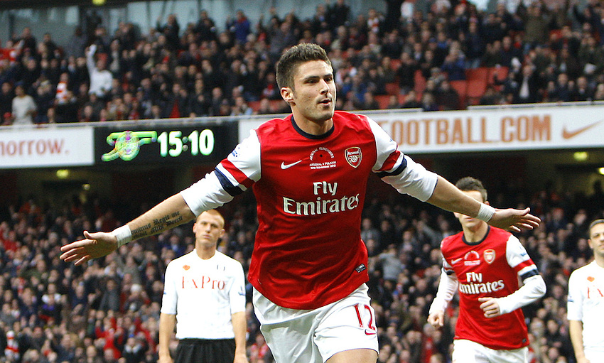 Arsenal's Olivier Giroud celebrates scoring his sides first goal 1-0..Football - Barclays Premiership - Arsenal v Fulham - Saturday 10th November 2012 - The Emirates Stadium - London ..