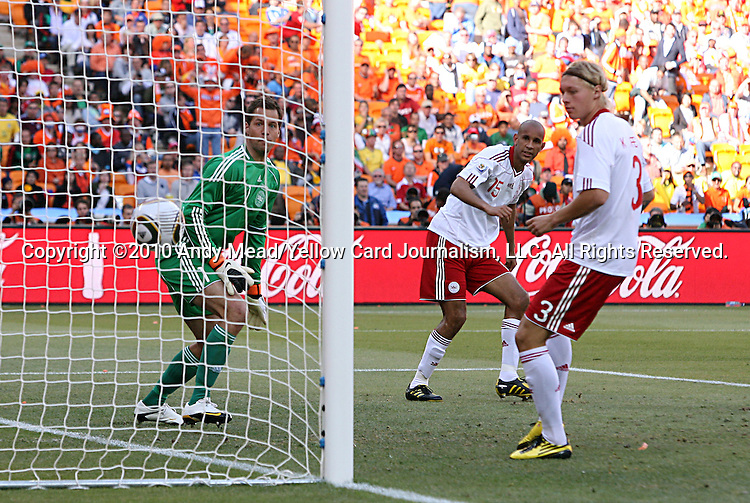 "14 JUN 2010:  Thomas Sorensen (DEN)(1) watches the game winning  ""own goal"" by Simon Poulsen (DEN)(15) cross his goal line as teammate Simon Kjaer (DEN)(3) looks on.  The Netherlands National Team defeated the Denmark National Team 2-0 at Soccer City Stadium in Johannesburg, South Africa in a 2010 FIFA World Cup Group E match."