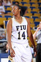 25 February 2012:  FIU guard Kamika Idom (14) waits for play to resume in the first half as the FIU Golden Panthers defeated the University of South Alabama Jaguars, 58-55 (OT), at the U.S. Century Bank Arena in Miami, Florida.