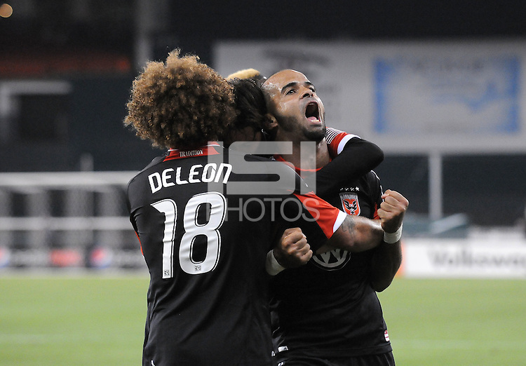 D.C. United forward Maicon Santos (29) celebrates with teammates Nick DeLeon (18) and Branko Boskovic (8) his second goal of the game in the 73th minute of the game. D.C. United defeated FC Dallas 4-1 at RFK Stadium, Friday March 30, 2012.
