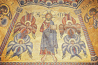 The Medieval mosaics of the ceiling of The Baptistry of Florence Duomo ( Battistero di San Giovanni ), showing Christ between angels. This panel is strongly influenced by Byxantine style probably through the Venetian craftsmen who made them. The angels are made to a typical Byzantine style and Christ is making the Orthododox blessing of the Eastern church with his hand.  Started in 1225 by Venetian craftsmen in a Byzantine style and completed in the 14th century. Florence Italy