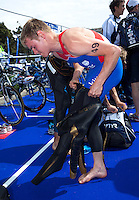 24 APR 2011 - NICE, FRA -  Tom Bishop (Rouen Triathlon) puts on his wetsuit before the start of the first round of the men's 2011 French Grand Prix triathlon series (PHOTO (C) NIGEL FARROW)