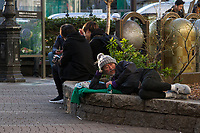 A homeless man resting a drinking Chu-Hi near Harajuku station in Tokyo, Japan. Friday March 8th 2019