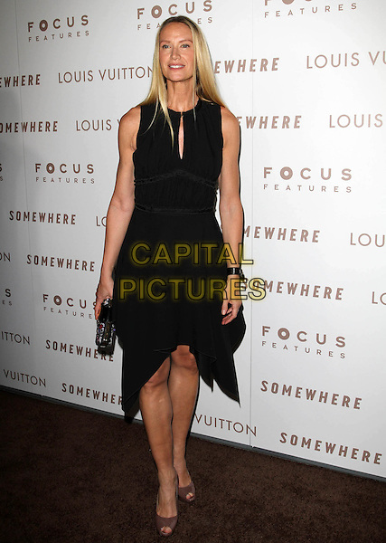 "KELLY LYNCH.Premiere of ""Somewhere"" held At The Arclight Theatres, Hollywood, CA, USA..December 7th, 2010.full length black sleeveless dress clutch bag.CAP/ADM/KB.©Kevan Brooks/AdMedia/Capital Pictures."