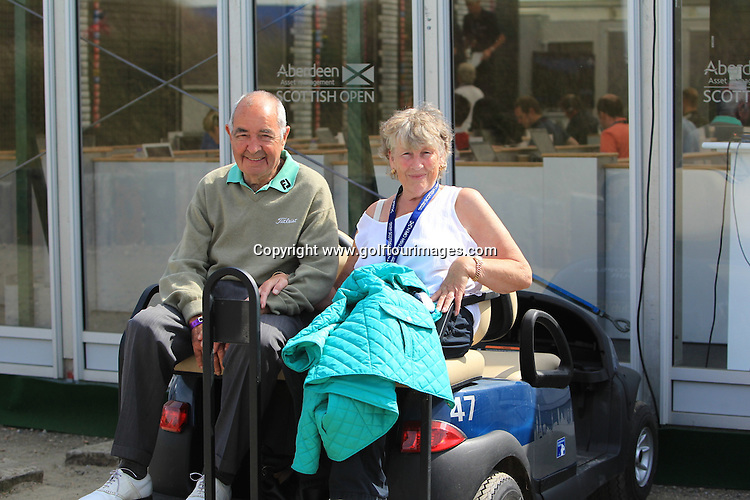 Bob Torrance and his wife June relax on a buggy outside the media centre during the second round of the 2013 Aberdeen Asset Management Scottish Open played over Castle Stuart Golf Links, Inverness, Scotland from 11th to 14th July 2013: Picture Stuart Adams www.golftourimages.com: 12th July 2013