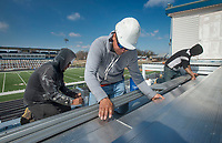 NWA Democrat-Gazette/BEN GOFF @NWABENGOFF<br /> Harley Saavedra (from left), Oscar Navarrete Juarez and Gabriel Madero with a crew from Southern Trades, Inc. out of Louisville, Ky., install new bleachers Thursday, March 1, 2018, in Gates Stadium at Rogers Heritage High. The stadium is getting all new aluminum bleachers on both the home and visitor sides, as well as a new walkway on the front of the home side.