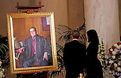 United States President Barack Obama and First Lady Michelle Obama  look at a portrait of Anthony Scalia after paying their respects to US Supreme Court Justice Anthony Scalia, in front of the casket bearing his body, in the Great Hall of the US Supreme Court, Washington, DC, February 17, 2016.  Anthony Scalia died February 13, 2016, at age 79, during a hunting trip in West Texas. <br /> Credit: Aude Guerrucci / Pool via CNP