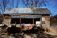 Plains, GA. December 1976. <br /> A poor black young man lays on a couch outside a house in Plains.<br /> Southerner Jimmy Carter is going to the White House. Born in Georgia, Carter is a democrat with a more open mind. A man who favors racial integration inspite of a majority of white people still living under misserable conditions. Officially, social barriers have been dropped, but racism still exists. If the South is on the rise and if in Georgia average salaries have trippled in the last 15 years, not everyone is benefitting from this economic boom. Perhaps, Jimmy Carter will seriously consider those who are in the lower end of the system's social scales.