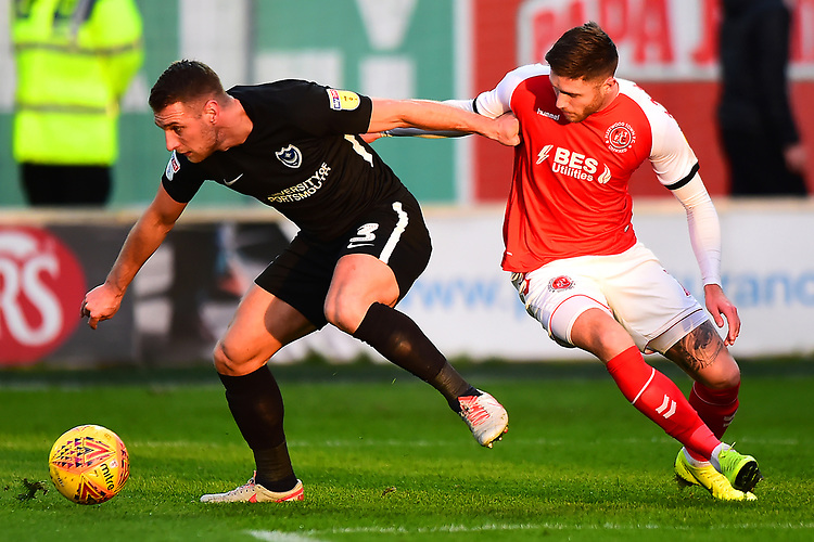 Portsmouth's Lee Brown holds off Fleetwood Town's Wes Burns<br /> <br /> Photographer Richard Martin-Roberts/CameraSport<br /> <br /> The EFL Sky Bet League One - Fleetwood Town v Portsmouth - Saturday 29th December 2018 - Highbury Stadium - Fleetwood<br /> <br /> World Copyright © 2018 CameraSport. All rights reserved. 43 Linden Ave. Countesthorpe. Leicester. England. LE8 5PG - Tel: +44 (0) 116 277 4147 - admin@camerasport.com - www.camerasport.com