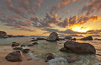 Virgin Gorda, British Virgin Islands, Caribbean <br /> Evening light on the beach with scattered boulders at The Baths National Park