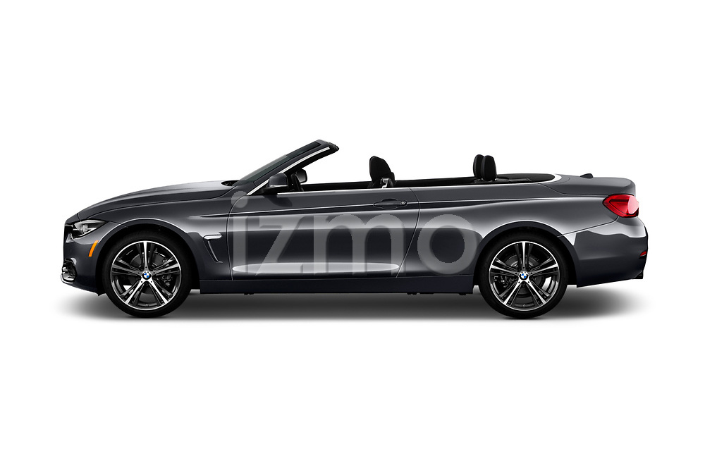 Car driver side profile view of a 2018 BMW 4 Series 430i 2 Door Convertible
