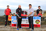"""Barry Faulkner (Fishermen's Co-op) presents the """"New"""" kit to Colin Kelly (Manager Dreadnots) during the Clogherhead Fishermen's Co-op Ltd sponsorship with the Dreadnots GFC on Tuesday 19th August 2014. Also in the back line: Pat Lynch, Donnacha Skinnader, Rian Keogh, Ella Carter, Anna Sharkey and Padraic Smyth.<br /> Picture:  Thos Caffrey / www.newsfile.ie"""