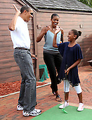 United States President Barack Obama and First Lady Michelle give thier daughter Sasha a high five after she got a hole in one at Pirate's Island Miniature Golf in Panama City Beach, Florida USA on Saturday,14 August  2010.  The First Family is visiting the area to help promote tourism and check up on clean up efforts from the aftermath of the Deepwater Horizon Oil spill..Credit: Dan Anderson / Pool via CNP