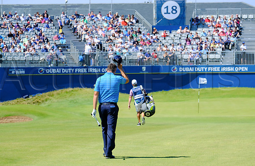 July 8th 2017, Portstewart Golf Club, Portstewart, Northern Ireland; Dubai Duty Free Irish Open Golf Championship, Day 3; Padraig Harrington (IRL) acknowledges the grandstand crowd as he makes his way towards the 18th green during the third round of the Dubai Duty Free Irish Open