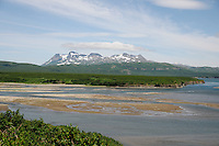View of the mouth of McNeil River as it empties into the tidal lagoon in Alaska's McNeil River State Game Sanctuary..