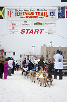 Linwood Fiedler and team leave the ceremonial start line at 4th Avenue and D street in downtown Anchorage during the 2013 Iditarod race. Photo by Jim R. Kohl/IditarodPhotos.com