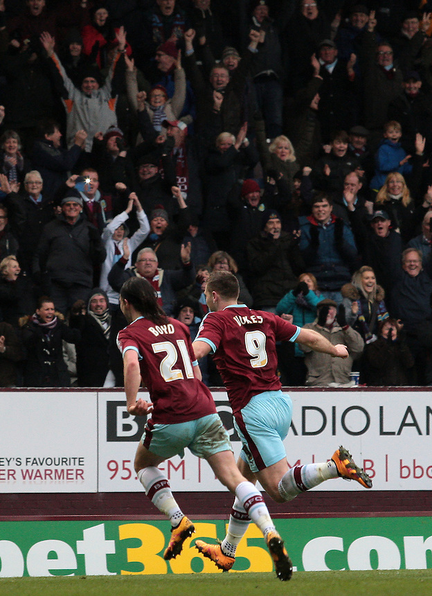 Burnley's Sam Vokes celebrates scoring his sides first goal <br /> <br /> Photographer David Shipman/CameraSport<br /> <br /> Football - The Football League Sky Bet Championship - Burnley v Wolverhampton Wanderers - Saturday 19th March 2016 - Turf Moor - Burnley<br /> <br /> &copy; CameraSport - 43 Linden Ave. Countesthorpe. Leicester. England. LE8 5PG - Tel: +44 (0) 116 277 4147 - admin@camerasport.com - www.camerasport.com