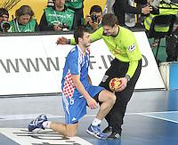 25.01.2013 Barcelona, Spain. IHF men's world championship, Semi-final. Picture show Niklas Landin Jacobsen and Domagoj Duvnjak in action during game between Spain vs Slovenia at Palau St. Jordi