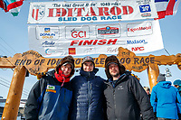 The three Redington Brothers, Ryan, Robert and Ray Jr. , pose at the finish line in Nome after they finished the 2017 Iditarod on Thursday March 16, 2017.<br /> <br /> Photo by Jeff Schultz/SchultzPhoto.com  (C) 2017  ALL RIGHTS RESERVED
