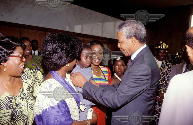 ©Giacomo Pirozzi / Panos Pictures..IVORY COAST..South African President Nelson Mandela meeting the public on a visit to the Ivory Coast.